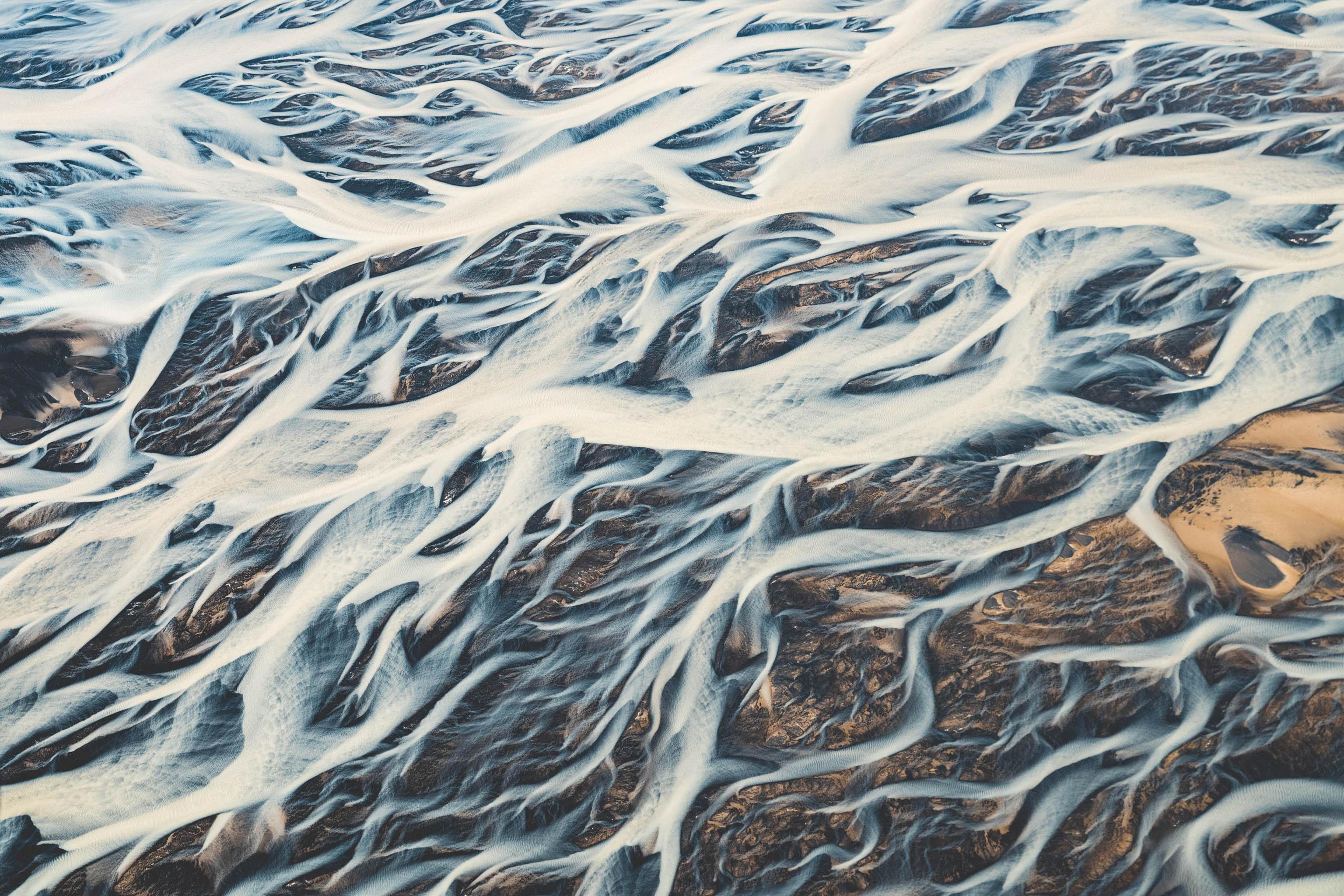 Iceland, glaciers, glacial river, aerial shot, bird's eye view